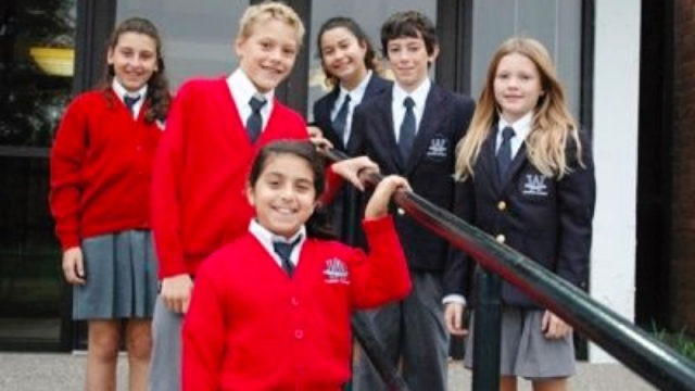 Westboro academy students in uniform, smiling.