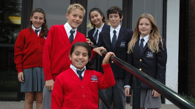 Westboro Academy students in uniform in front of school