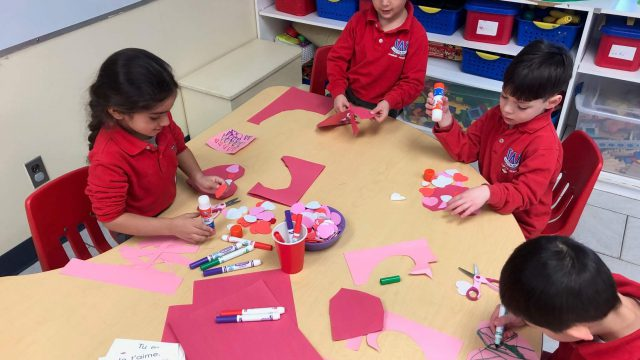 Students making Valentine's day crafts