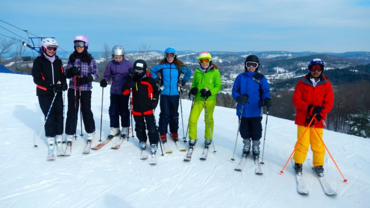 Students on skis at a ski hill