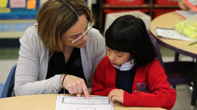 Teacher helping student with an assignment