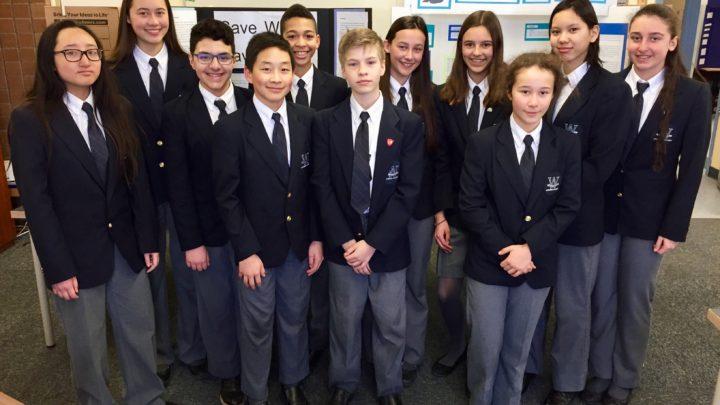 Grade 8 class wearing their formal uniform
