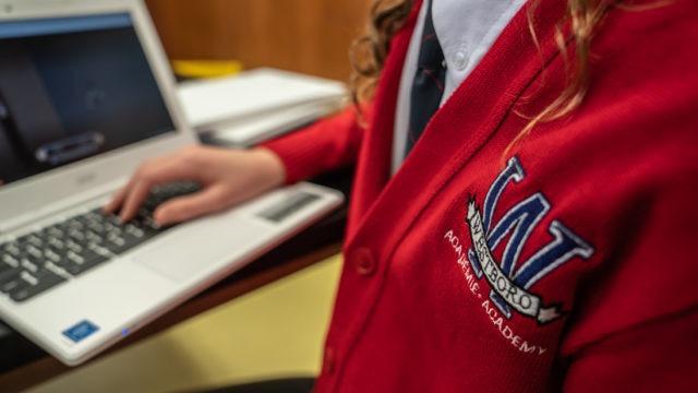 Westboro Academy crest on a cardigan